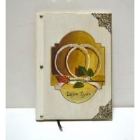 Εικόνα προϊόντος βιβλίου ευχών γάμου με στέφανα και τοίχο