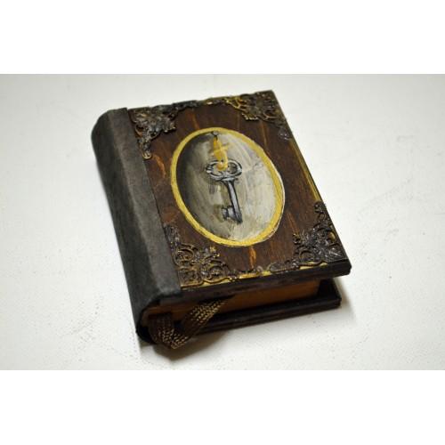 Εικόνα προϊόντος σημειωματαρίου τσέπης με ένα κλειδί